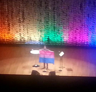 Margaret Cho holding the bisexual flag